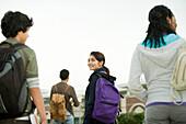 Teenage girl walking with classmates