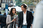 Couple walking and talking together outdoors