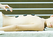 Woman having lastone therapy massage