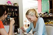 Female friends having coffee in cafe