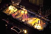 Tilt-shift of skaters on an ice rink at night, Strasbourg, France