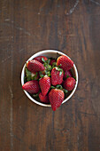 Directly above shot of strawberries in bowl on table