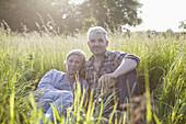 Portrait of confident mature couple taking break from gardening