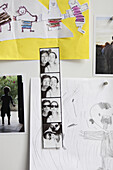 Photos and drawings on wall