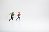 Two boys running against white background