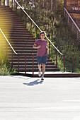 Mid adult man jogging