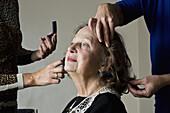 Makeup artist applying compact powder on woman face
