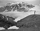 Woman looking at view at Leduc Glacier, British Columbia, Canada