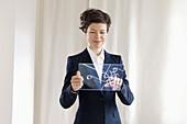 Confident Businesswoman Using Futuristic Digital Tablet
