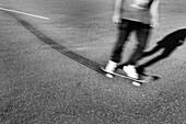 A skateboarder leaving tire tracks