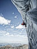 Ice climber on icefall, Hintertux Glacier, Hintertux, Tyrol, Austria