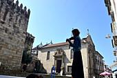 Musician at the Cathedral, Braga, Minho, Northwest-Portugal, Portuga