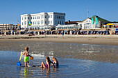 Children playing on the beach, Weststrand, Norderney, Ostfriesland, Lower Saxony, Germany