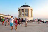 People in front of the pavilion on the beach promenade, Borkum, Ostfriesland, Lower Saxony, Germany