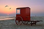 Beach hut on the beach at sunset, Borkum, Ostfriesland, Lower Saxony, Germany