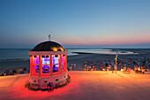 Illuminated pavilion on the beach promenade, Borkum, Ostfriesland, Lower Saxony, Germany