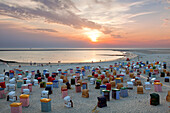 People on the beach watching the sunset, Borkum, Ostfriesland, Lower Saxony, Germany