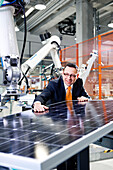 Business man inspecting solar module production in the manufacturers, Berlin, Germany, Europe