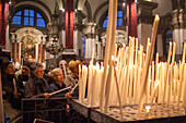 candles being lit in Santa Maria della Salute church, built in gratitude of surviving the plague, an annual memorial festival is held in November, Venice Italy