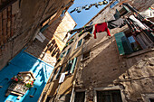 typical, washing line strung outside across narrow, alley, callo,  shrine, view from below, Castello, Venice, Italy
