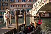 Venetian Carnival, tourism, masks, fantasy, angel, bird, wings, costume, posing, Rialto Bridge, Venice, Italy