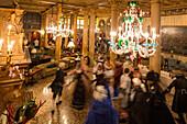 Carneval, dancing guests in costumes, Palazzo Zeno ai Frari, piano nobile, noble floor, private masked ball, carnival, chandelier Murano glass, Hotel Danieli, Venice, Italy