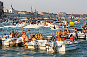 Festa del Redentore, Redentore Feast Day, thanks that the plague ended, party boats anchored, Giudecca, sunset, 3rd Sunday of July, San Marco in background, Venice, Italy