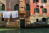 washing line, above canal, facade, canal, water, stone walls, bricks, empty, still, decay, Venice Italy
