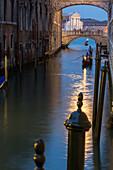 Ponte della Paglia beyond the Bridge of Sighs, background church of San Giorgio Maggiore, gondola, reflections, evening, romantic, night time, Venice, Italy