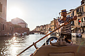 gondolier Kuba, rowing on a canal in Cannaregio, tourist ride, tourism, Venice, Veneto, Italy