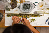 glass bead artists at Atelier Gioia of Luisa Conventi, threading beads, jewellery, Venice, Italy