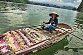 Boat vendor in Halong Bay, Vietnam.