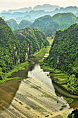beautiful limestone karst mountains over the Tam Coc River in Ninh Binh, Vietnam.
