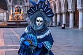 A masked woman at the carnival in Venice, Italy, Europe