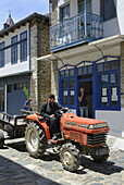 Greece, Chalkidiki, Mount Athos peninsula, listed as World Heritage, Orthodox monk driving a tractor in the streets of Karyes, the small capital of Mount Athos.