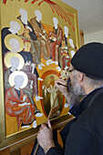 Greece, Chalkidiki, Mount Athos peninsula, World Heritage Site, Skete Prodromos (Timiou Prodromou), Monk painting an icon of the Pentecost.