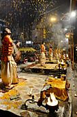 India, Uttar Pradesh, Varanasi, Offering of flowers to the Ganges.