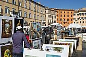 Art vendors, Piazza Navona, Rome, Italy.