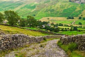 Nanny Lane leading to Troutbeck on the side of Wansfell in the Lake District, Cumbria, England.
