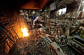 traditional blacksmith at work in Holland.
