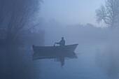 man in mist in national park 'de biesbosch' in Holland.