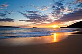 Hawaii, Maui, Makena - Big Beach, Beautiful Sunset Over Ocean And Shoreline, Molokini Island In Distance.