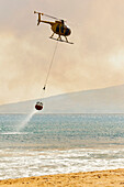 Hawaii, Maui, Ma'alaea, Fire Helicopter Collecting Ocean Water To Help Put Out Wildfire. Editorial Use Only.