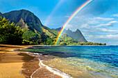 Hawaii, Kauai, Haena Beach Tunnels Beach, Rainbow Over Coastline.
