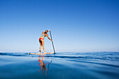 Hawaii, Maui, Paia, Young Woman Stand Up Paddling Shore/N/Nno Commercial Use