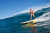 Hawaii, Maui, Paia, Female Stand Up Paddle Boarder Rides A Wave On Maui's North Shore/Nno Commercial Use