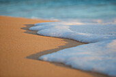 Hawaii, Maui, Makena, Sea Foam Over Sand At Sunset