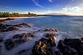 Hawaii, Big Island, South Kohala, Hapuna Beach, Water Washing Onto Rocks, Cloudy Sky.