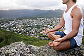 Hawaii, Oahu, Lanikai, Male Hiker Admiring View Of Doing Yoga At The Top Of The Pill Box Hike.