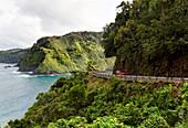 Hawaii, Maui, Car Traveling Along The Cliffs Of Road To Hana.